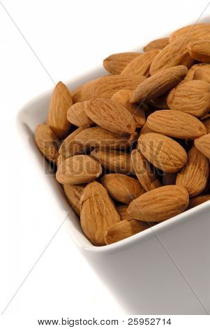 White Ceramic Bowl Of Almonds Isolated On A White Background