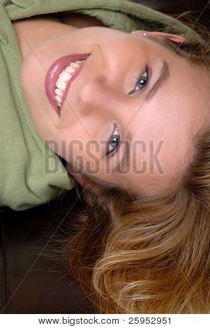 Pretty Girl Lying Down On An Ottoman