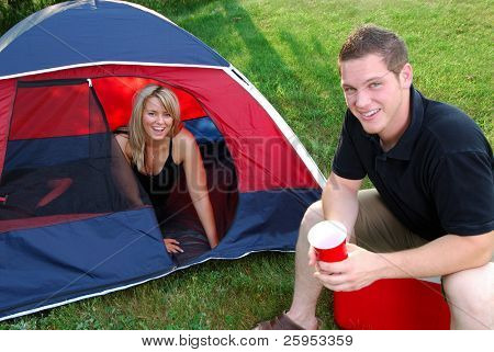 Man And Woman Couple Camping In A Tent In The Countryside