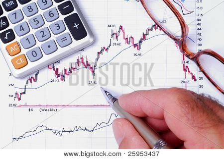 Man Checking The Results Of A Stock Chart