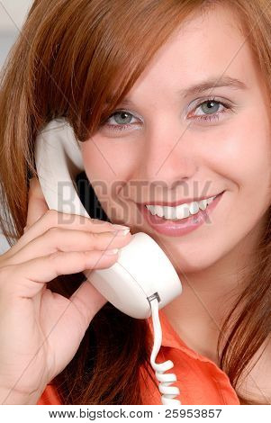 Beautiful Red Head Young Woman Speaking On The Phone