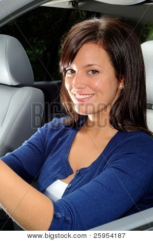 Attractive Young Woman Sat In The Drivers Seat Of Her car