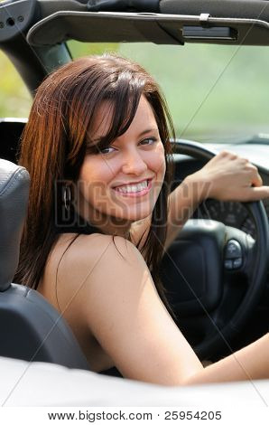 Beautiful Brunette Young Woman Sat In A Convertible Sports Car