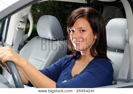 Attractive Woman Sat In The Drivers Seat Of A Family Vehicle