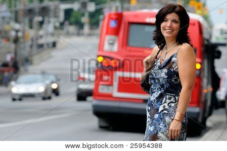 Woman On A City Street With Traffic In The Background