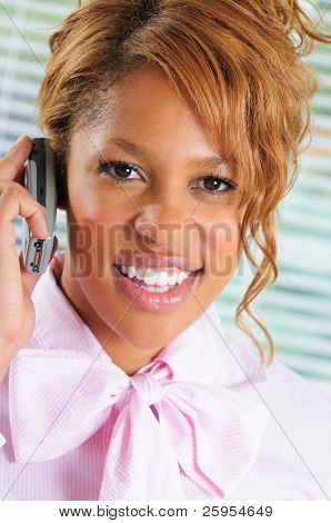 Smiling African American Businesswoman Using Her Mobile Cellphone