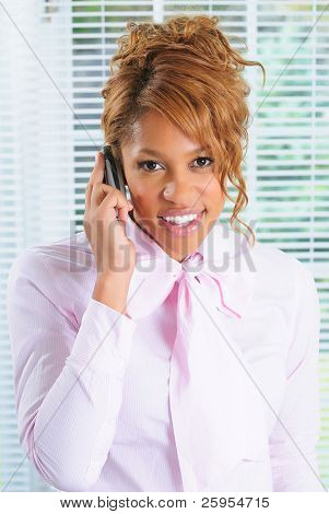 Smiling Attractive Businesswoman Using Her Mobile Cellphone