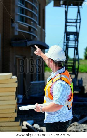 Project Manager Checking Out A New Building Construction
