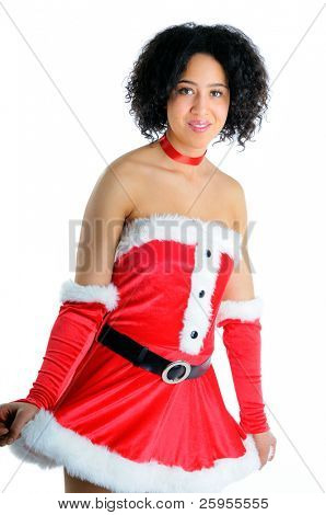 Beautiful Young African American Woman Standing Dressed In A Sexy Santa Christmas Costume Isolated On A White Background