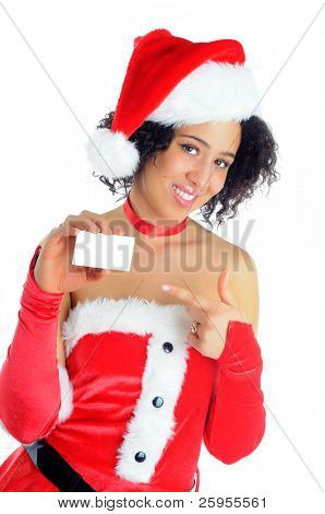Beautiful African American Young Woman Standing Holding A Blank Sign For Your Message Dressed In A Sexy Santa Christmas Costume Isolated On A White Background