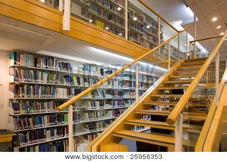 Modern library interior, a lot of books on the bookshelves