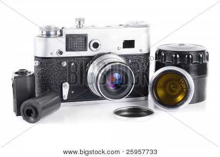 Old 35 mm rangefinder camera with extra lens isolated over white