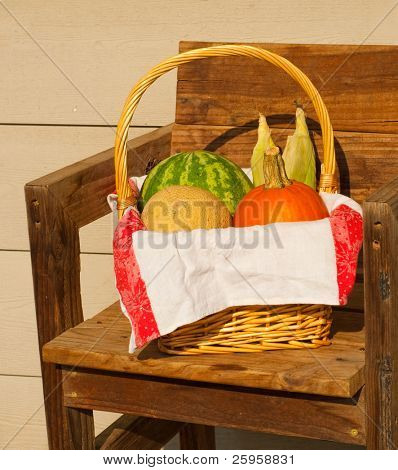 Produce in a wicker basked lined with a classic old linen towel, against rustic background