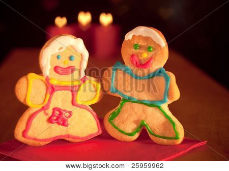 Two delightful Christmas sugar cookies, a girl and a boy, holding hands