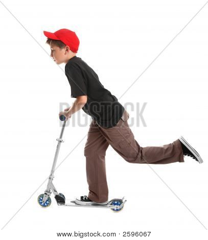 Child Riding A Scooter Toy
