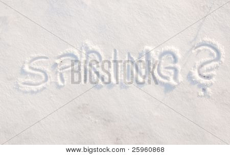 Word spring? scribbled in snow - concept of being tired of cold weather, ready for spring to arrive