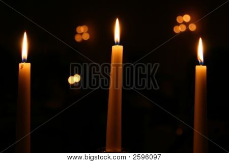Three Candles Burning At Night