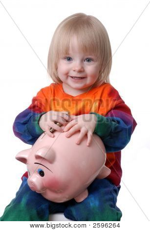 Toddler Holding Piggy Bank