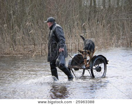 RescueMan rescue dog from flood