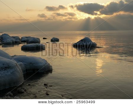 Sunset at the beach in winter (Latvia). Stones are nice icing.