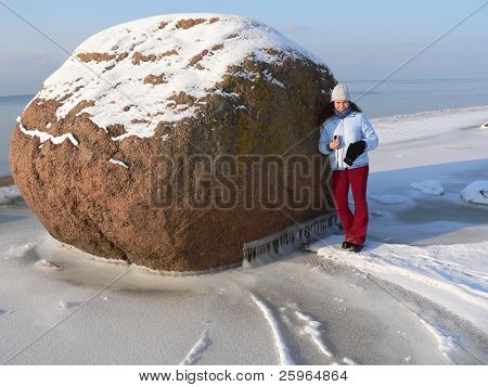 Big stone, litle girl and winter