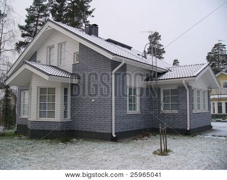 New house in Nordic countrie by snowfall