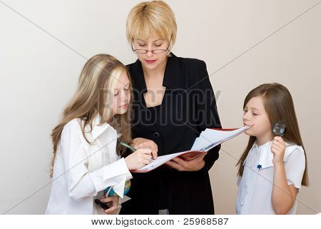 Two schoolgirls with the teacher