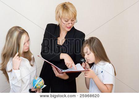 Two schoolgirls with the teache