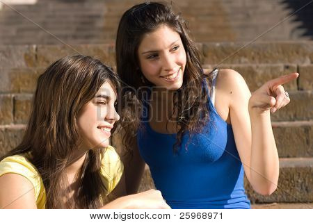 Dialogue of two girls. Cheerful conditions