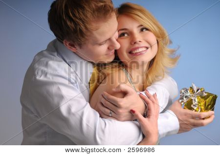 Young Happy Attractive Couple With Gift