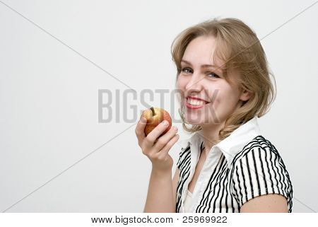 The woman with a pear on a light background