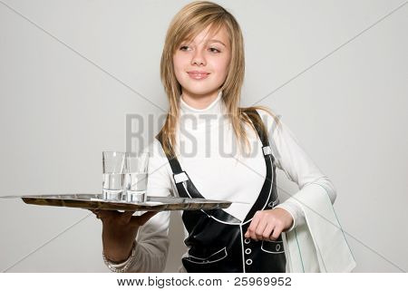 The young waitress with a tray in hand