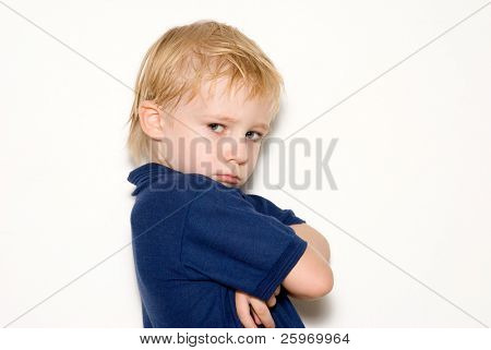 The little, offended boy on a light background