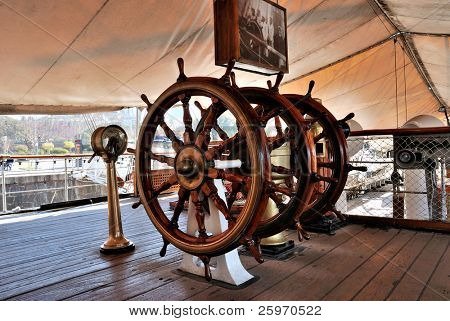 Military frigate. Threefold steering wheel of big sailing boat