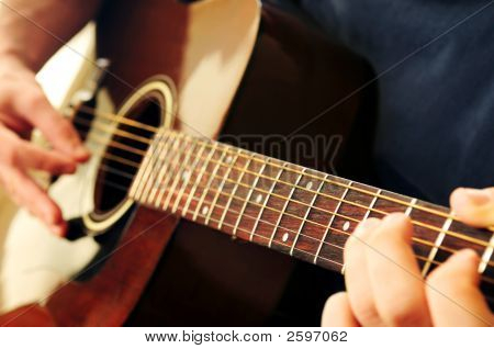 Man Playing A Guitar