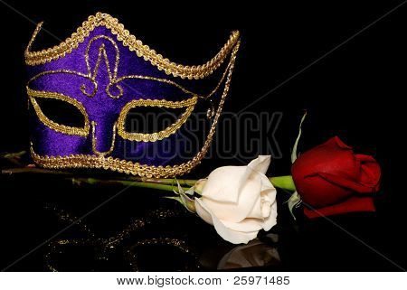 The Venetian mask and flowers on a black background