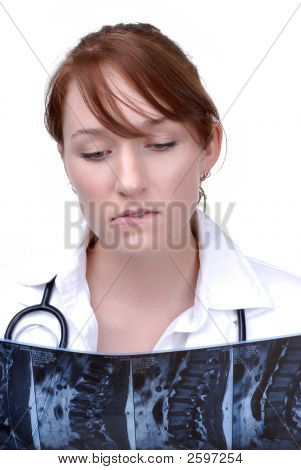 Female Doctor Checking An Mri
