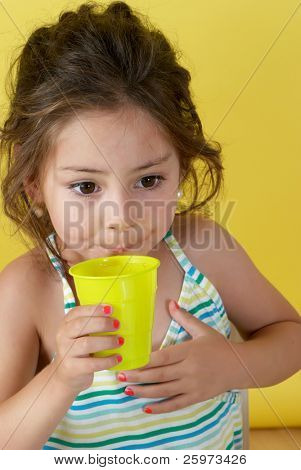 The little girl with a water glass