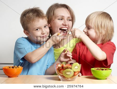 Happy family with fruit salad