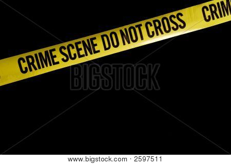 Police Crime Scene Tape Against Black
