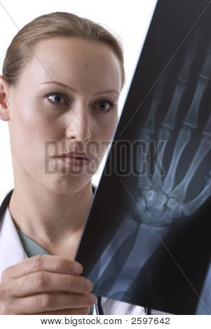 Female Doctor Reviewing An X-Ray