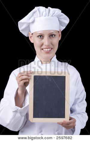 Female Chef With Blank Menu Board