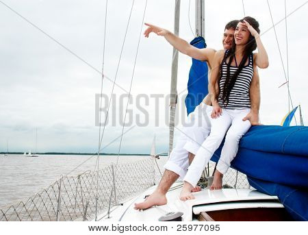 Young couple onboard the yacht during a vacation