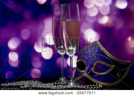 lasses with champagne and Venetian mask