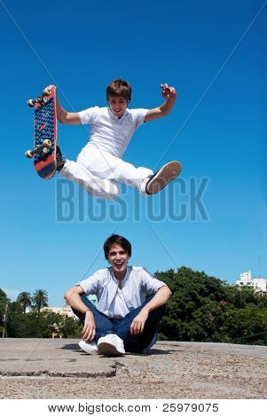 Skateboarder on a high and dangerous jump