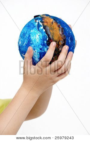 Children's hands holding globe made the child