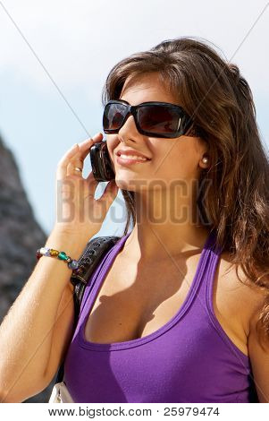 Portrait of the girl in sunglasses and mobile phone