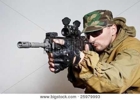 Portrait of  the soldier with an automatic assault rifle