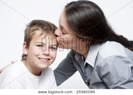 Happy mother and son on light background
