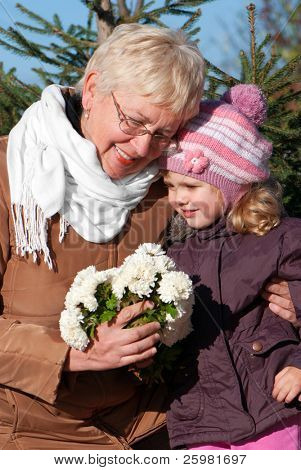 happy grandmather and granddaughter in park